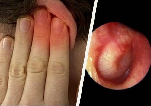 Mano che tappa l'orecchio e timpano