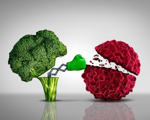 Broccoli che prendono a pugni una cellula tumorale