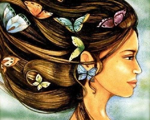 Donna con farfalle nei capelli
