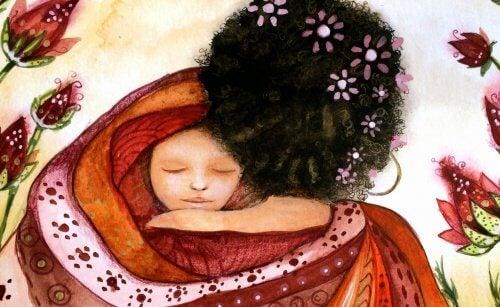 mamma che abbraccia neonato