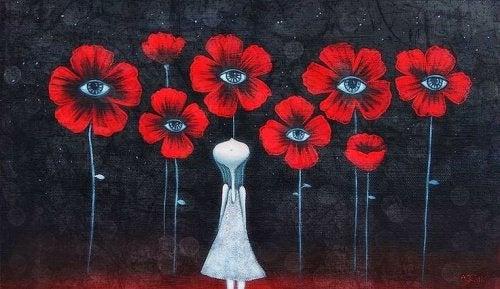 donna circondata da fiori con al centro un occhio