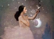 donna triste che sorregge la luna