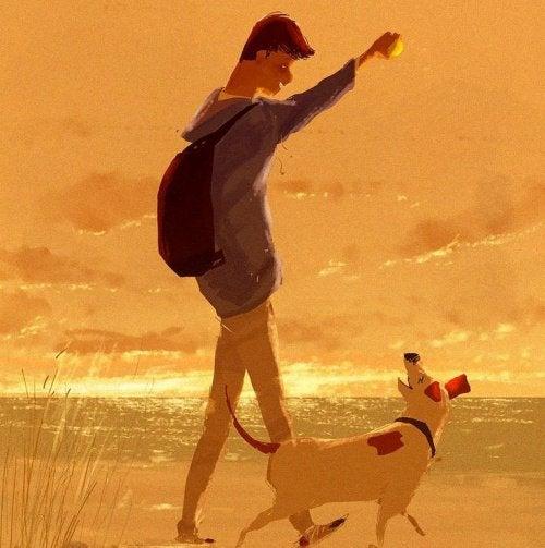 ragazzo con il cane sulla spiaggia