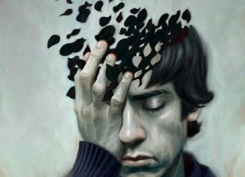 Uomo con mal di testa l'amore