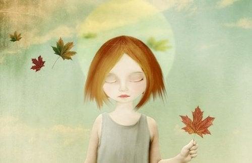 bambina triste con foglia in mano dolore fisico
