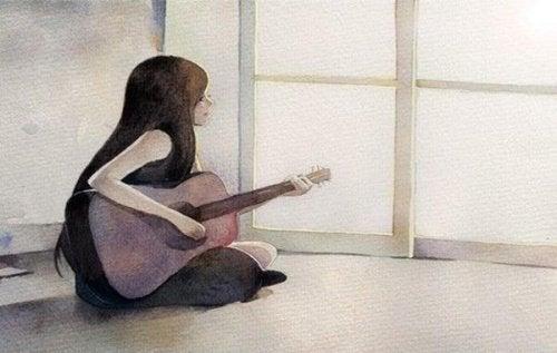 ragazza che suona la chitarra e pensa mi amo