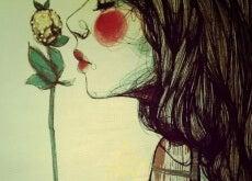 meritare donna-che-annusa-un-fiore