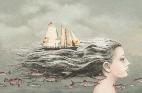 lasciar andare il passato- donna con velieri sui capelli e pesci