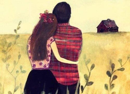 coppia che si abbraccia e guarda l'orizzonte