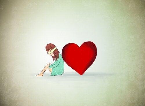 ragazza con benda sugli occhi e cuore