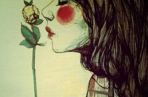 donna che annusa un fiore aspettarsi