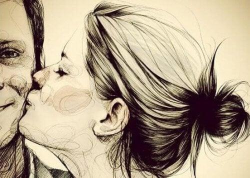 donna che bacia un uomo aspettarsi