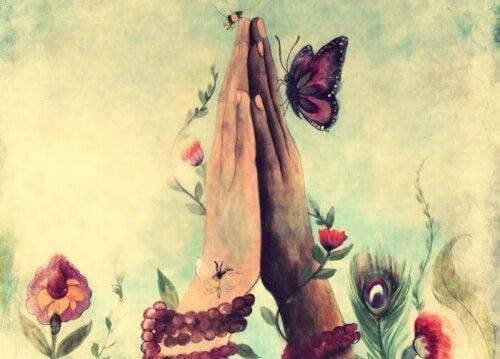 mani-giunte-con-fiori-e-farfalle coscienza