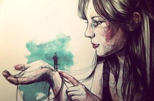 Donna con uomo piccolo sulla mano autostima