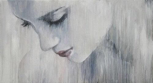 Donna triste che guarda in basso delusioni