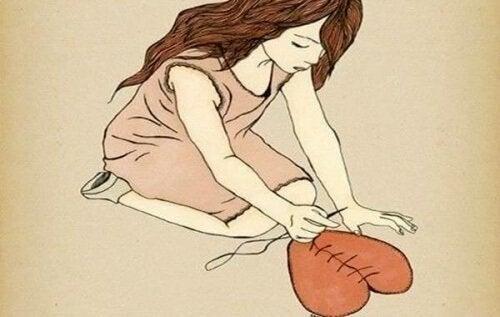 Ragazza-che-cuce-un-cuore relazioni liquide