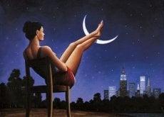 donna con i piedi sulla luna