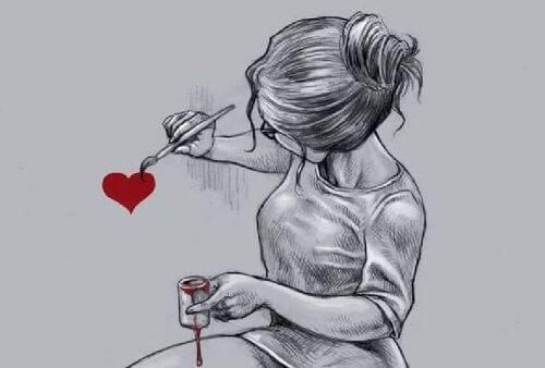 Ragazza disegna un cuore