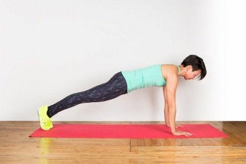 Plank con spinta