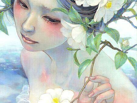 Donna con fiore in mano