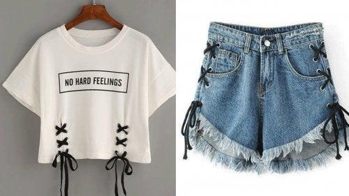 maglietta e pantaloncini con lacci neri