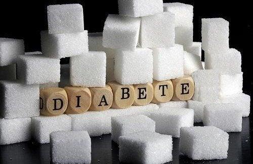 Zollette di zucchero e scritta diabete