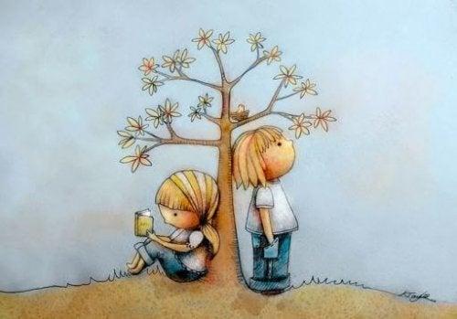 Disegno di bambini sotto un albero e lettura con il metodo doman