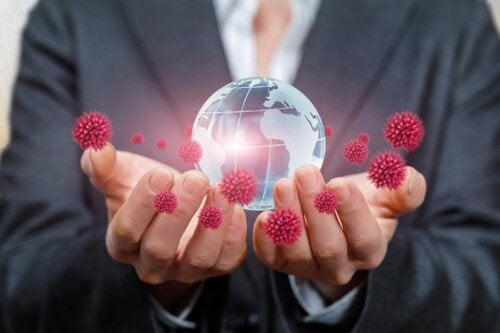 Pandemia: mani, coronavirus e globo terrestre