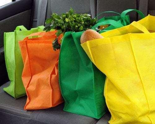 Borse di stoffa colorate per fare la spesa.
